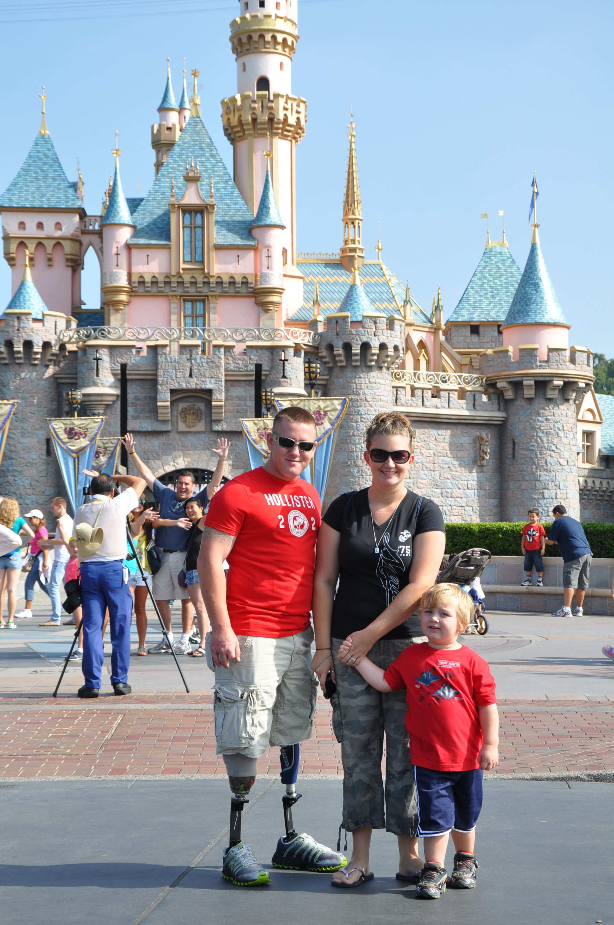 A military family reconnects during a retreat in Southern California. Here they are seen in front of the Disneyland Castle.