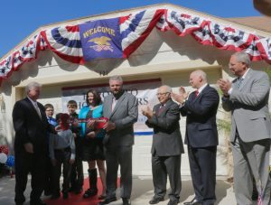 Freedom Alliance president Tom Kilgannon presents a home to a military family in Florida.