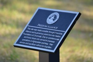 A plaque commemorating the construction of a new dock and Kayak launch at the Camp LeJeune wounded warrior unit.