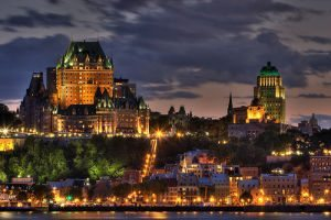 A view of Quebec City, Quebec, Canada at night from the St. Laurence River.